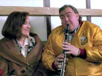 John Candy plays the clarinet in the back of the truck with Kevin's mom