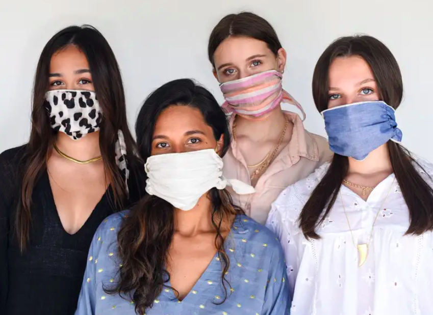 Four people wearing the scarf masks