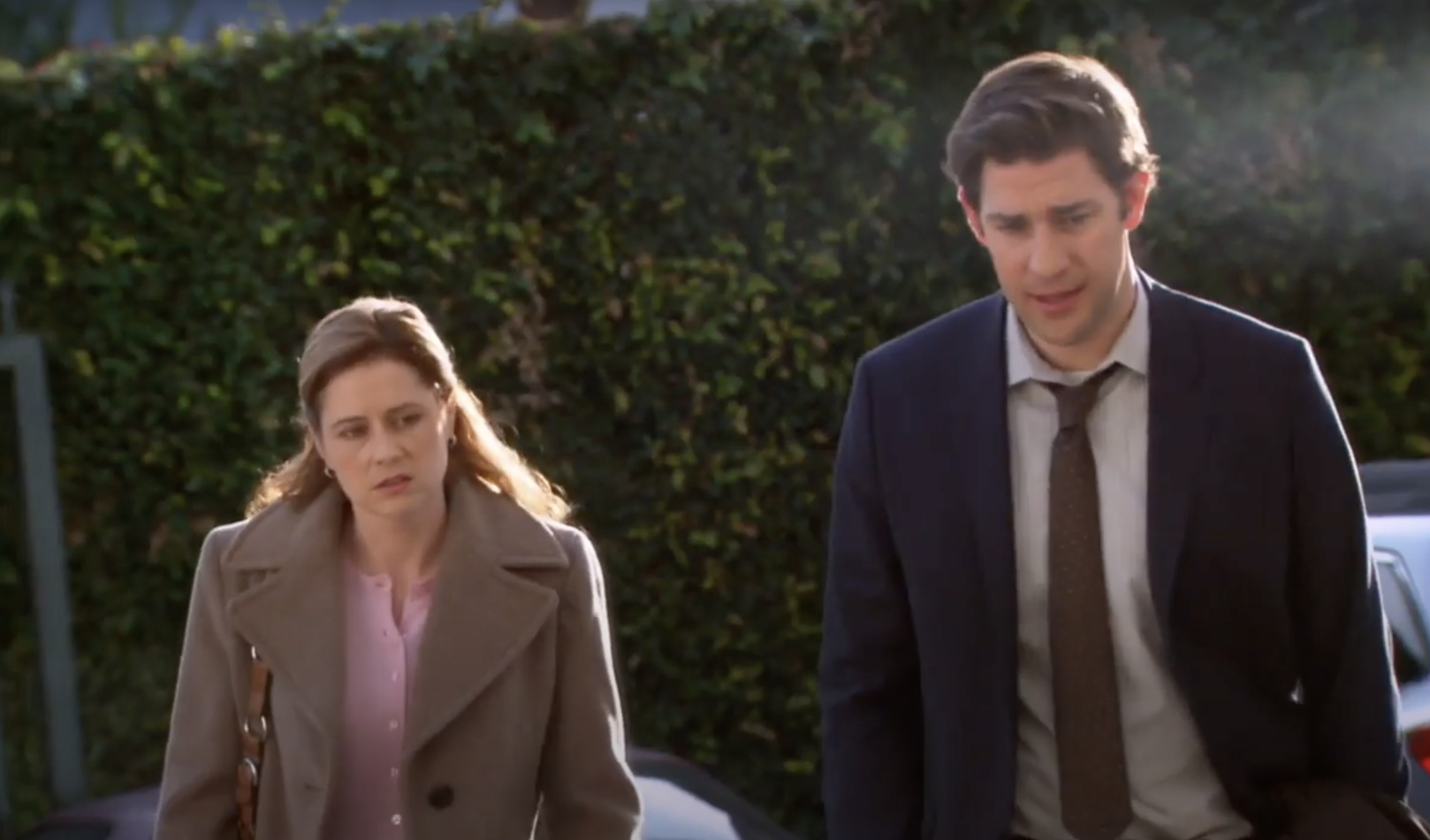 Jim and Pam walking together with annoyed expressions on their faces