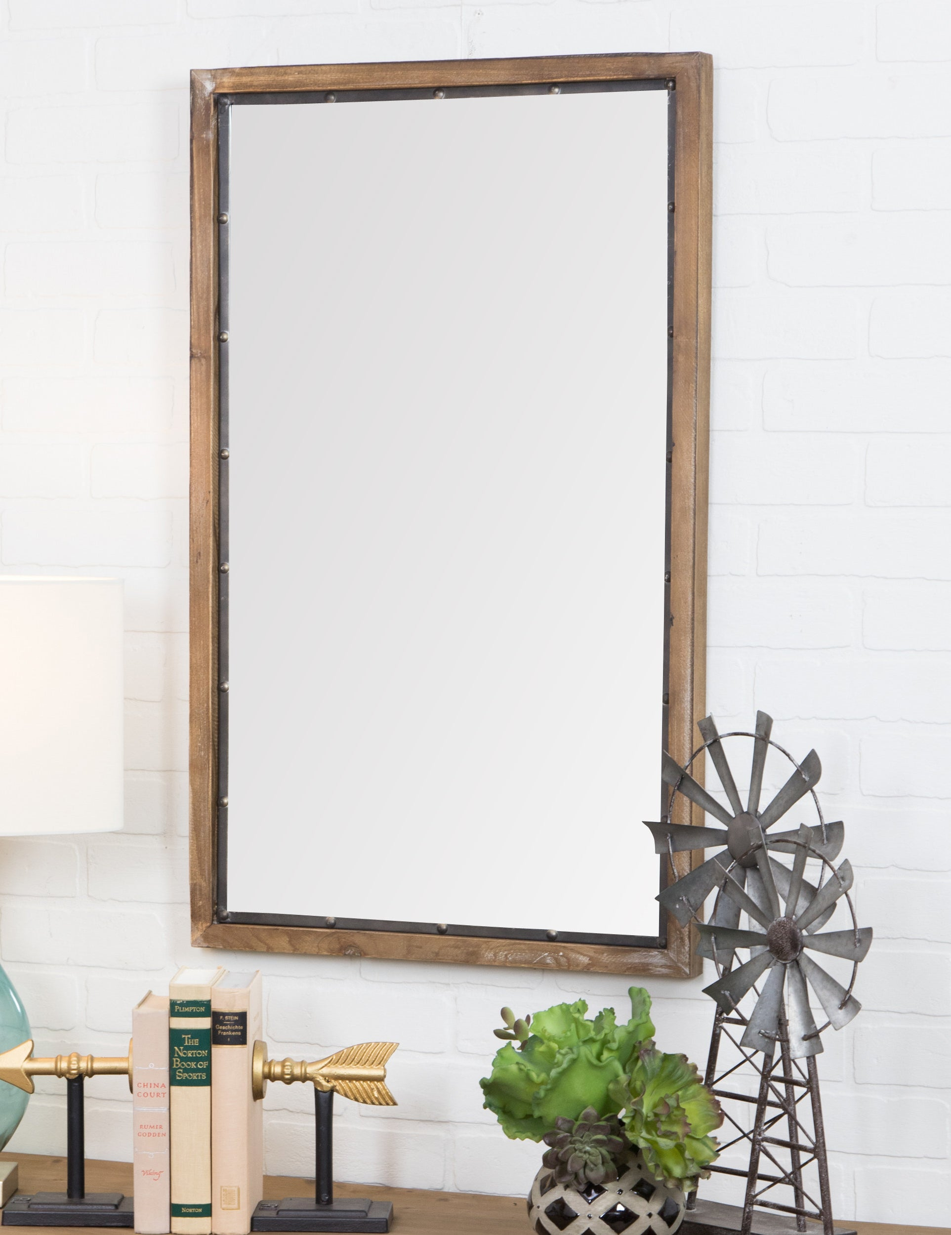 The large mirror with wooden frame