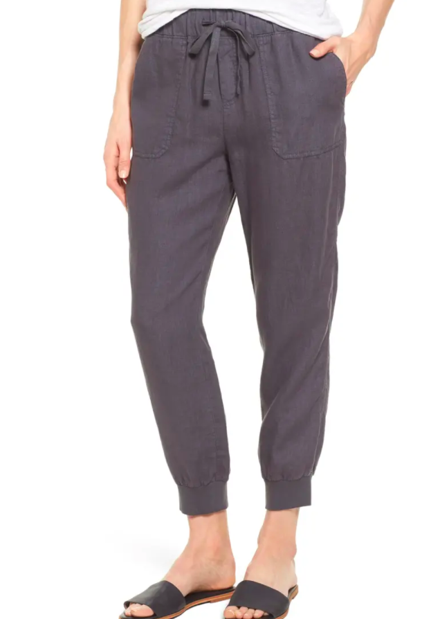 A model wearing the pants in dark gray
