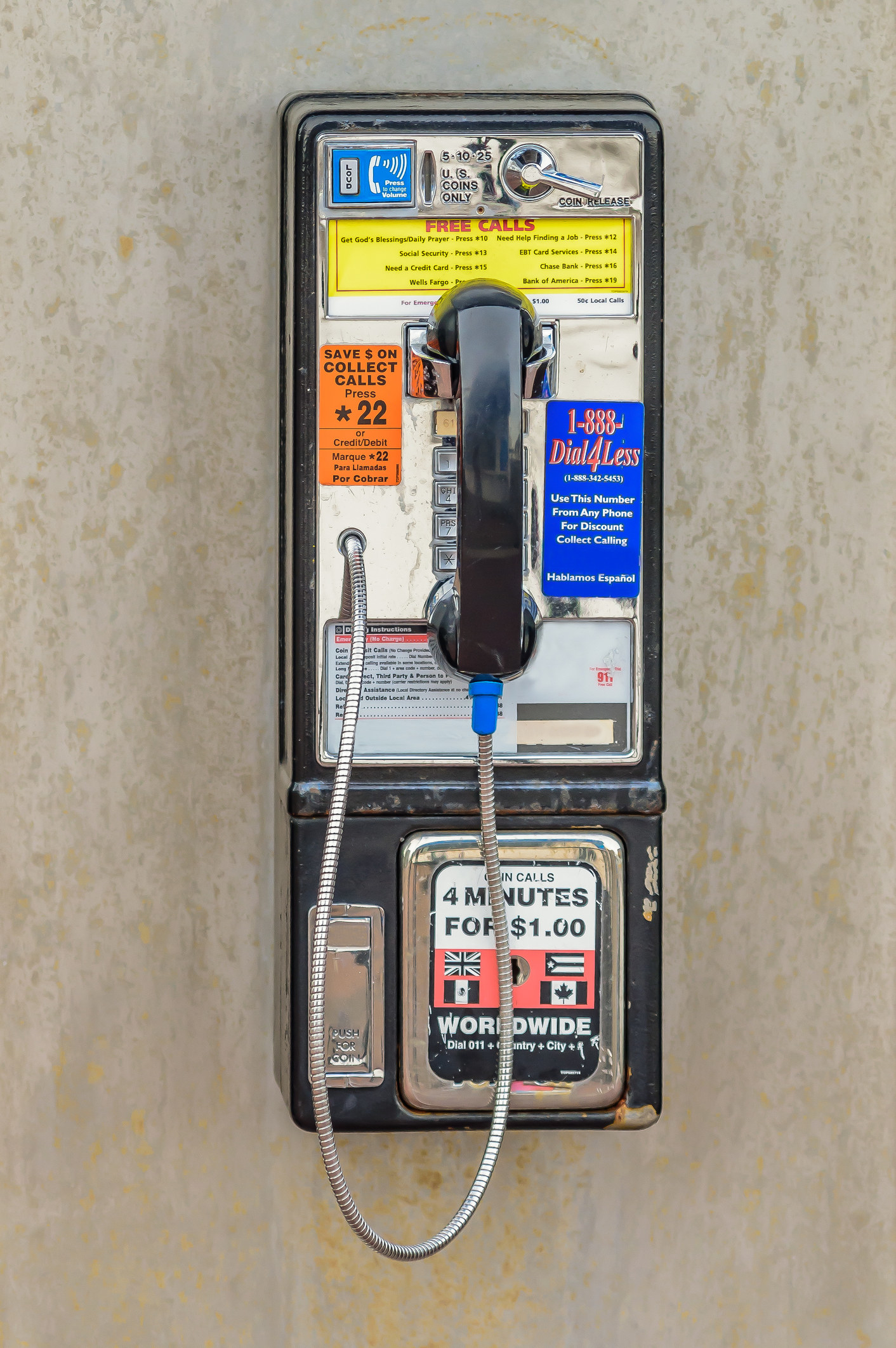 A stock photo of beat up pay phone.