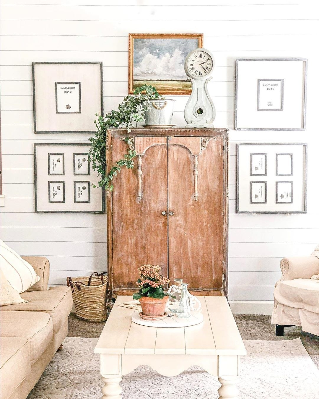 A farmhouse-styled living room uses a wooden armoire as the focal point