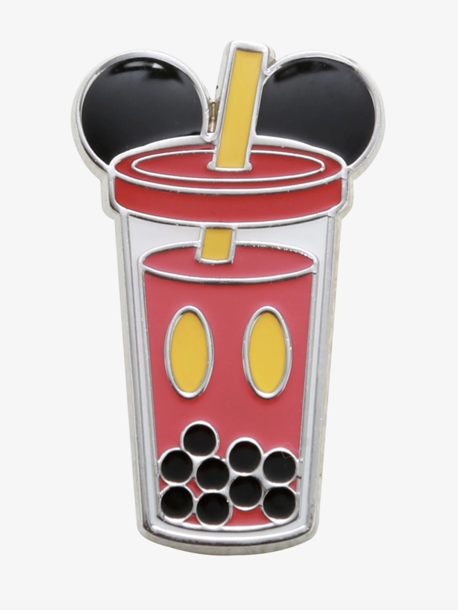 an enamel pin designed to look like a combo of mickey mouse and boba tea