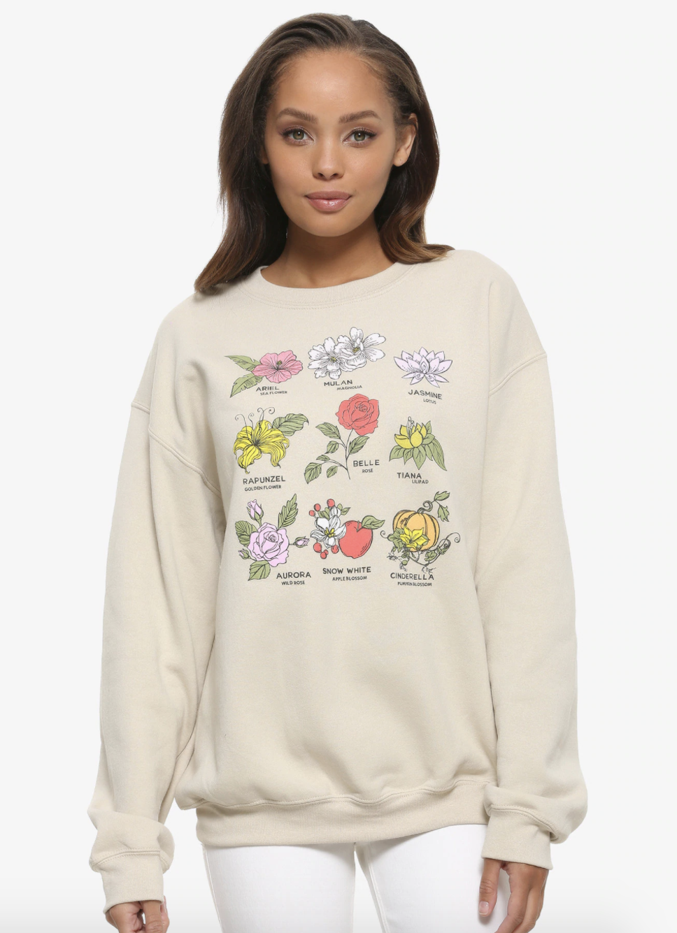 a model in a tan sweatshirt with different flowers to represent each princess and the princess' name under it