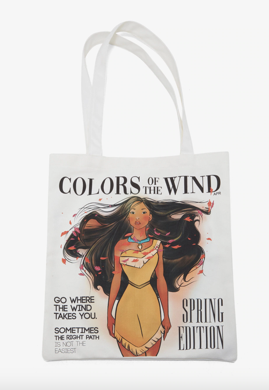 a white tote bag with an illustration of pocahontas on it with leaves blowing through her hair and various magazine captions