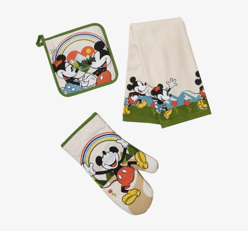an oven mit, pot holder, and dish towel with mickey and minnie and rainbows on them