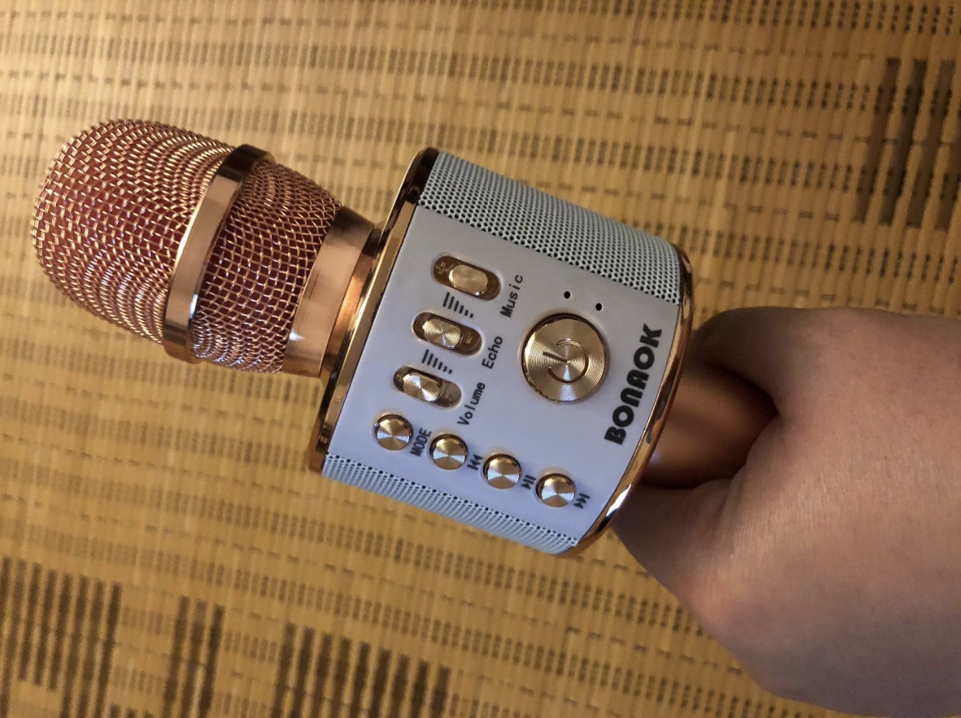 Reviewer image of a rose gold mic showing the volume and echo controls