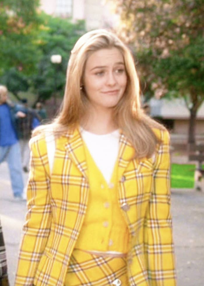 Cher wearing a plaid blazer and matching skirt with a vest