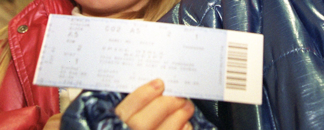 A close-up of a paper ticket.