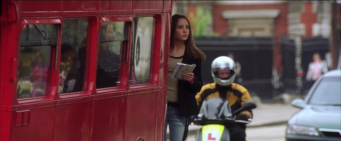 Daphne riding on a red bus in London.