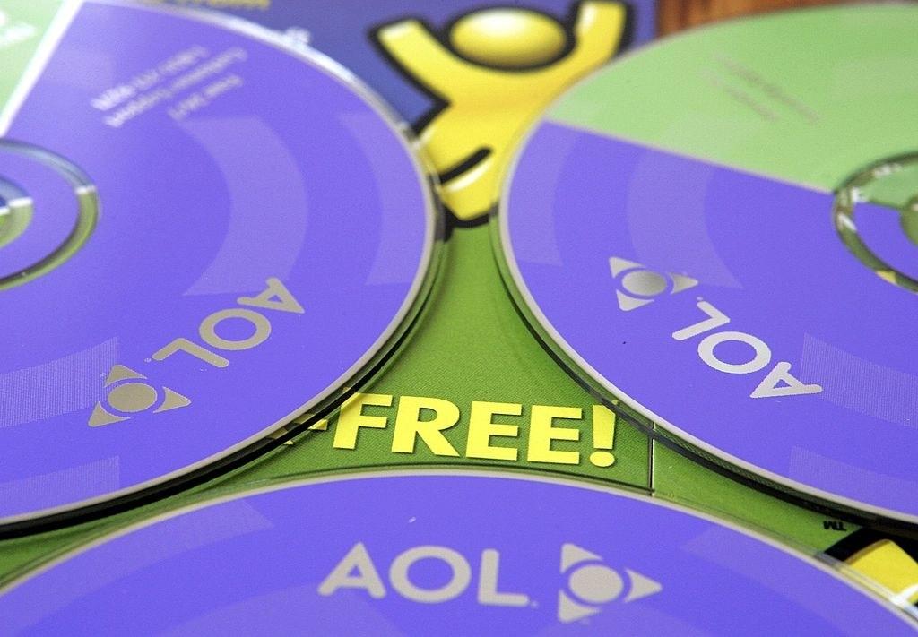 A close up of purple AOL CD-Roms.