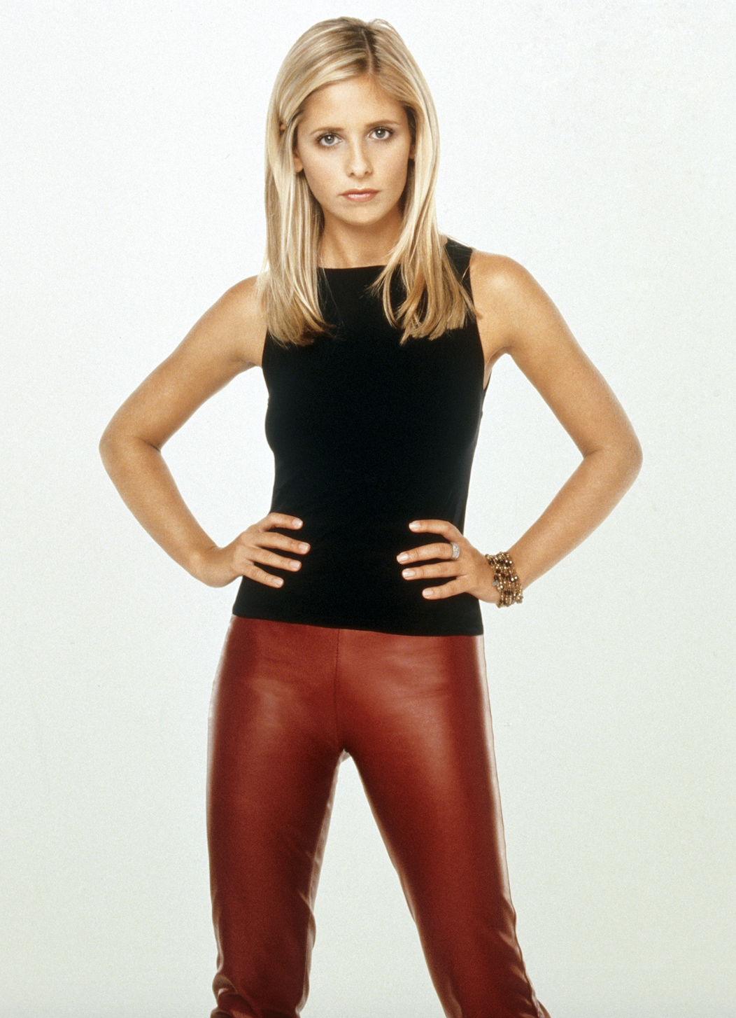 Buffy wearing a top with colorful leather pants