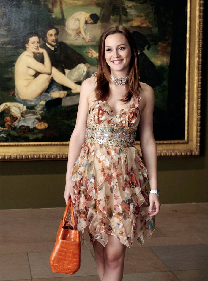 Blair wearing a ruffed floral dress with stones and jewels around her waist