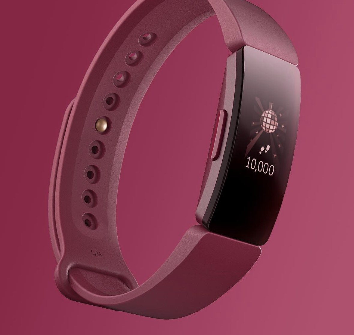 A sangria colored Fitbit wristwatch with a digital screen/face