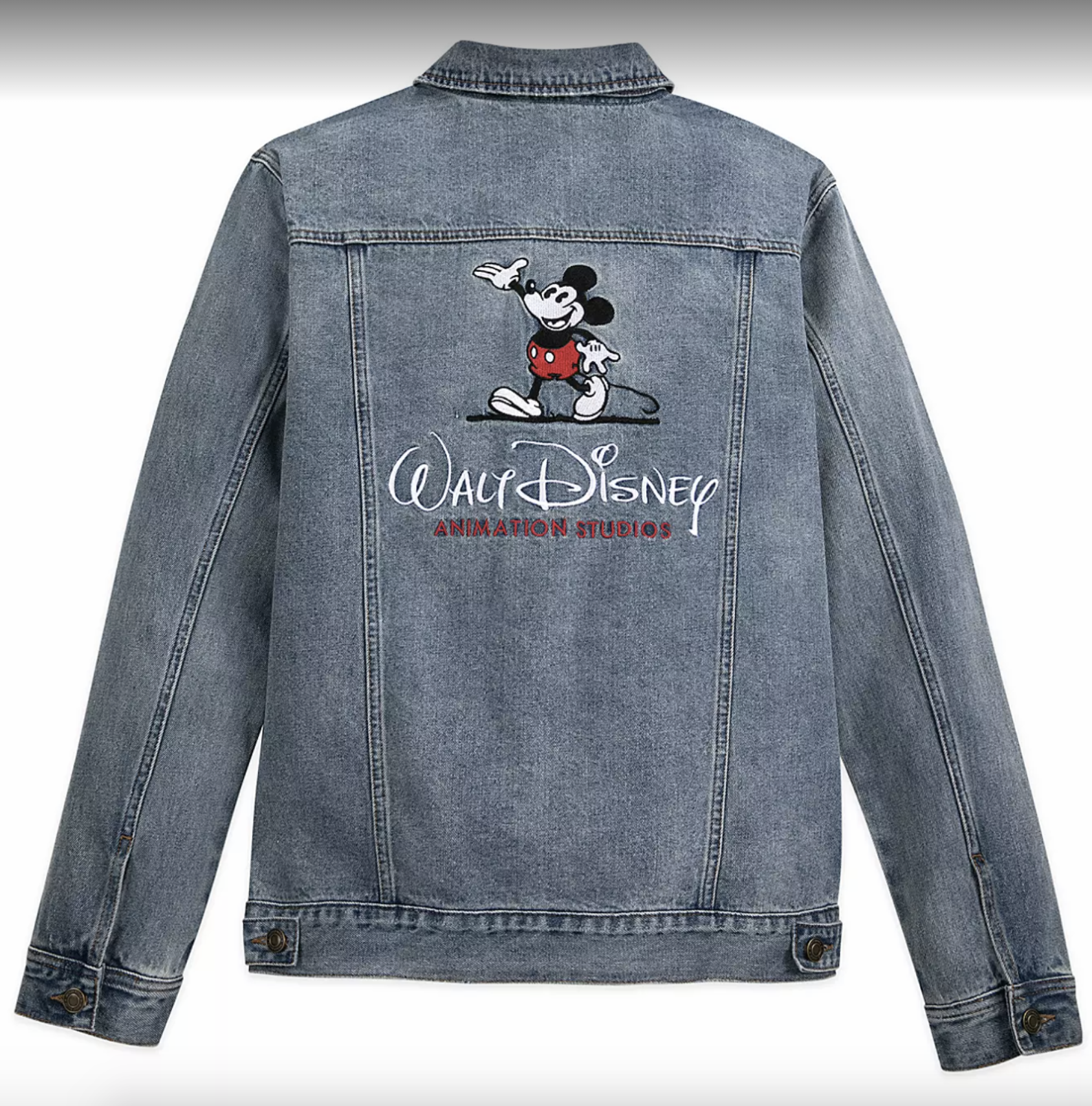"A denim jacket embellished with an old-fashioned Mickey Mouse waving and the words ""Walt Disney"" in swooping, white thread above ""Animation Studios"" in smaller, red thread."