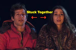 "Nyles and Sarah from ""Palm Springs"" with the text ""stuck together"" between them"