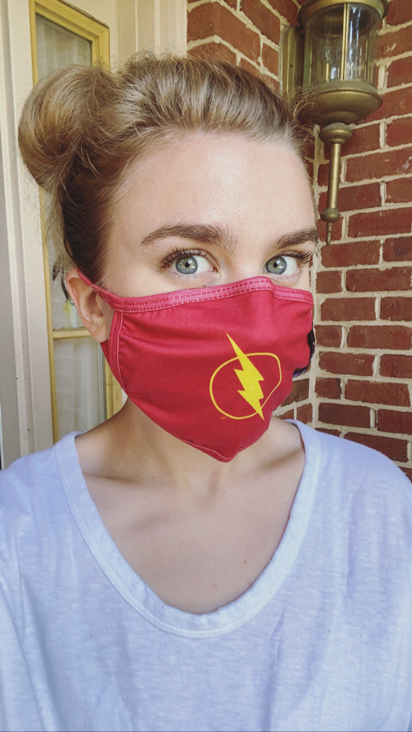 A BuzzFeed editor in a red mask with The Flash logo
