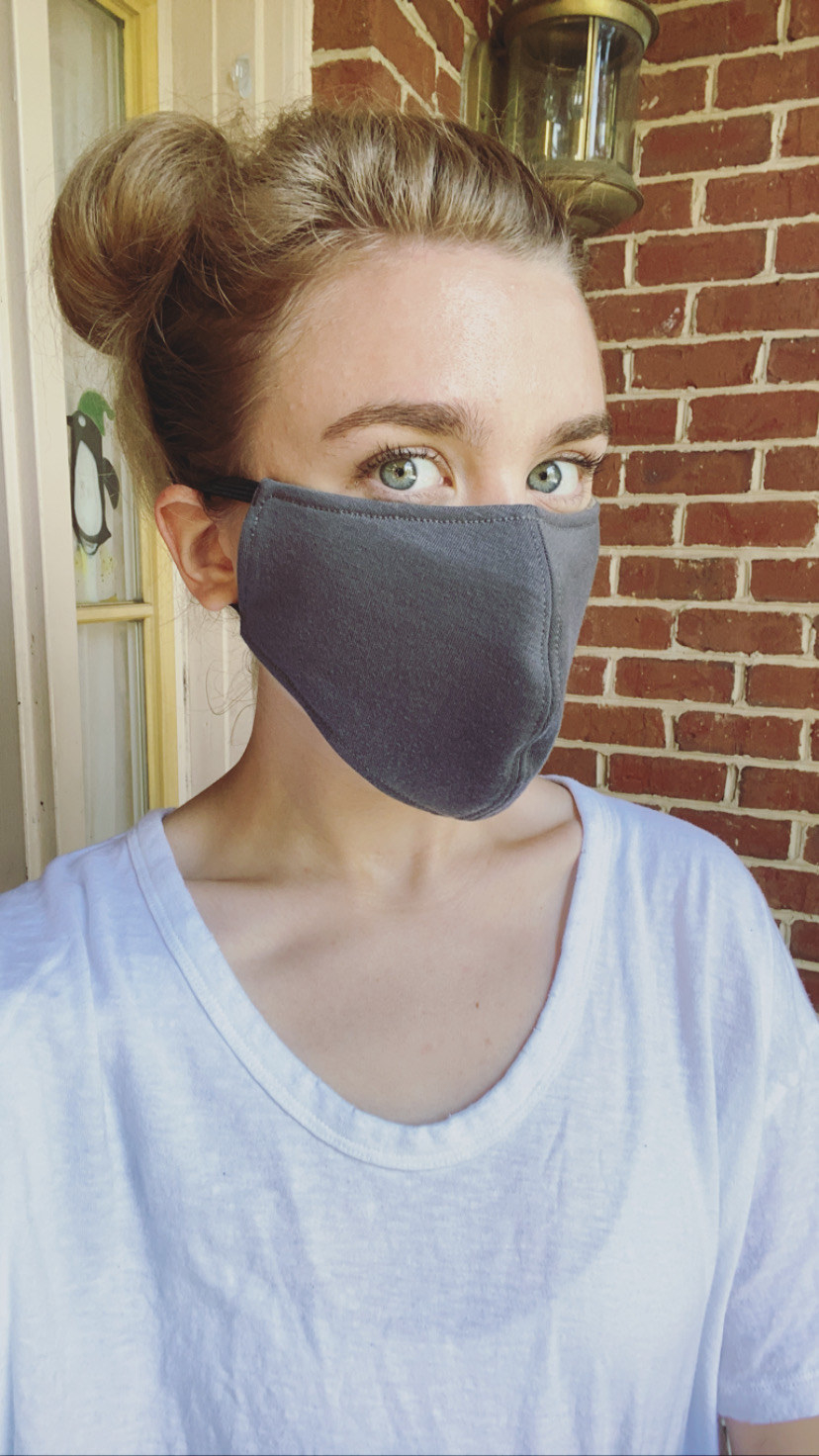 A BuzzFeed editor in a gray face mask