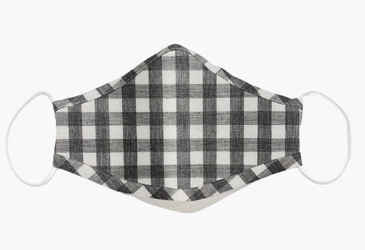 A plaid black and white face mask