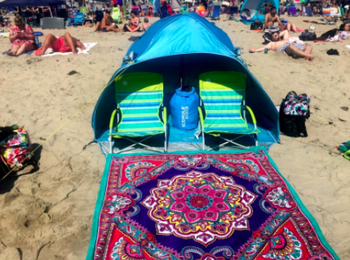 Reviewer uses same beach chairs and a blue tent to create a shady spot at a beach