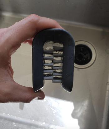 reviewer photo of bristled gray brush