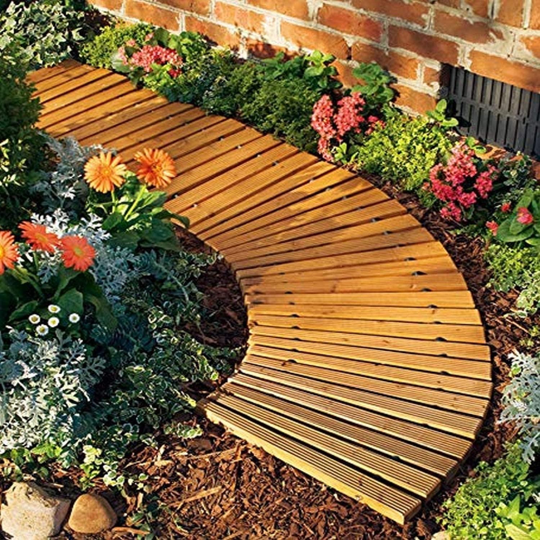 a cedar path curving around a garden