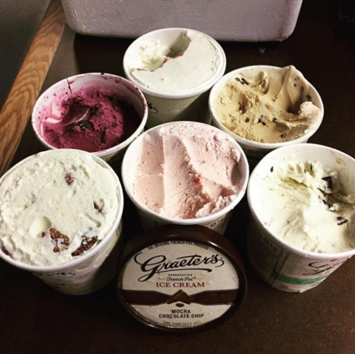 Seven pints of different ice cream flavors