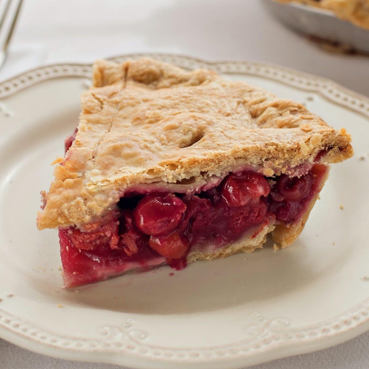 A slice of fresh Grand Traverse Pie Company's cherry pie on a white plate.
