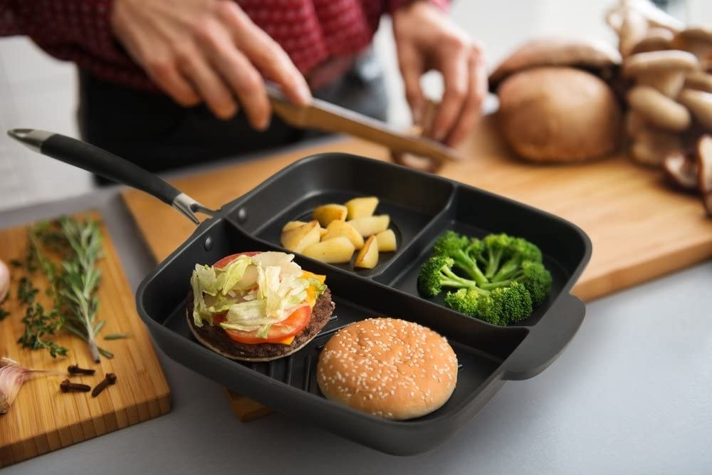 The pan, featuring three divided compartments