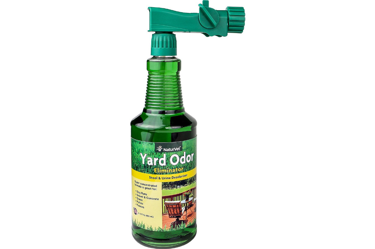 a green bottle of yard odor eliminator