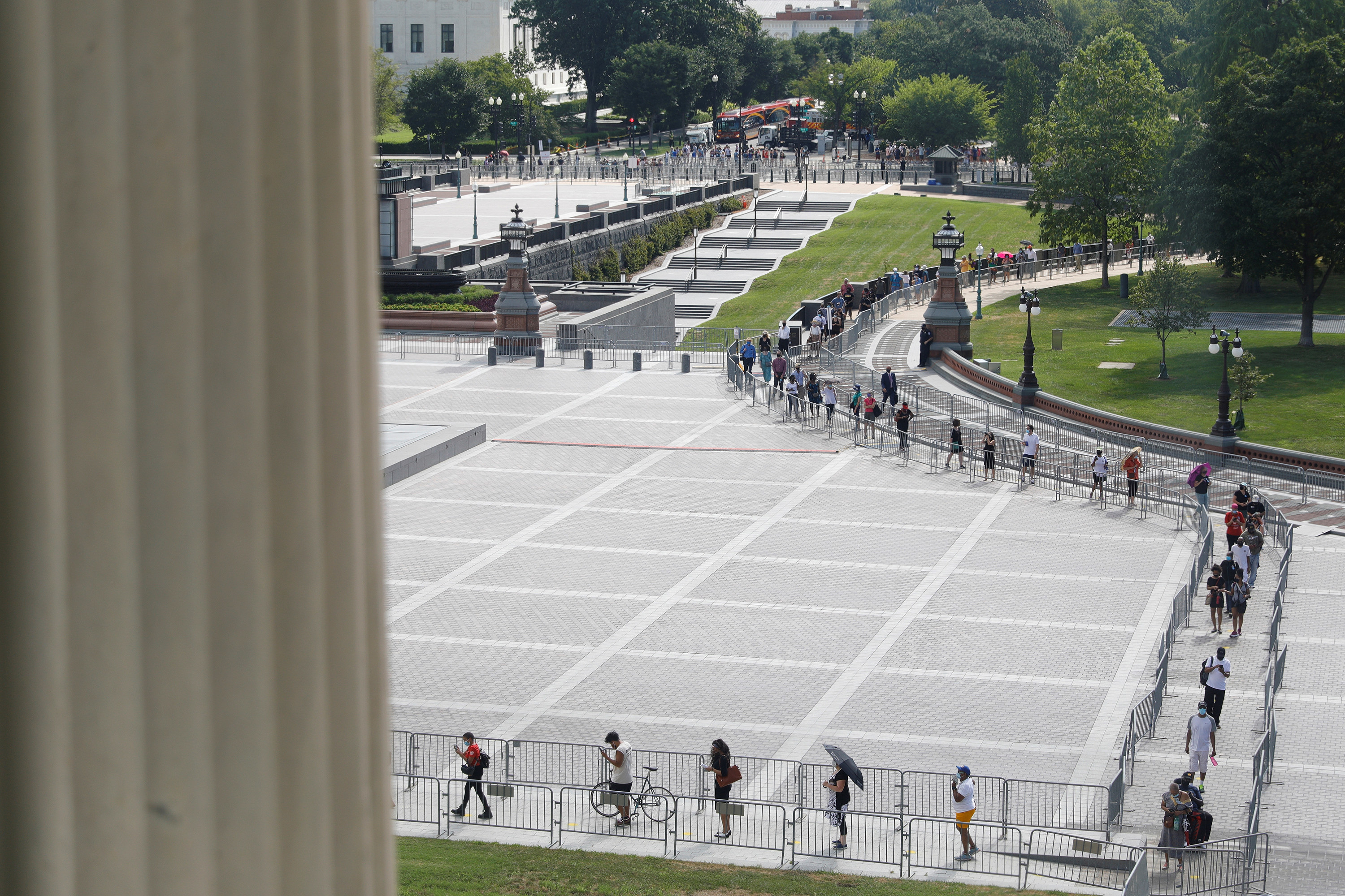 Visitors form a socially distanced queue outside the Capitol