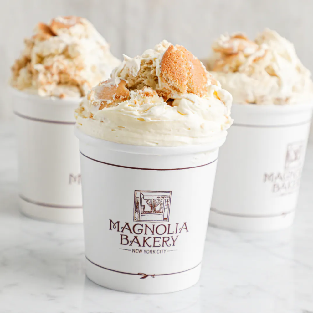 Three cups of Magnolia's bakery fluffy whipped banana pudding with Nila wafers on top.