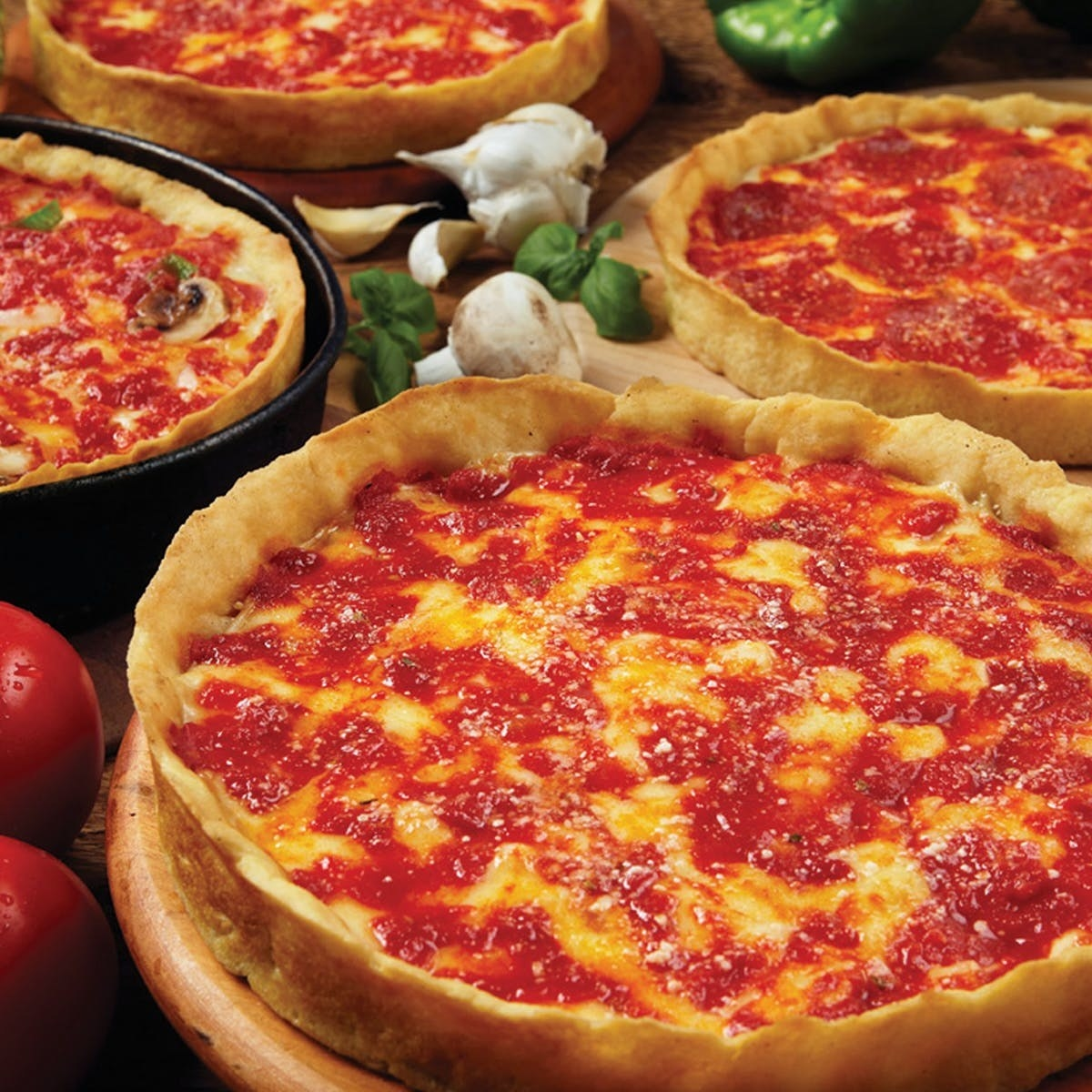 Four deep dish cheese pizzas from Lou Malnati's.