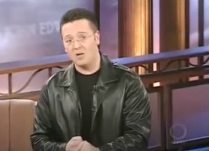 """A screengrab of John Edwards in leather jacket on the set of """"Crossing Over with John Edward"""""""