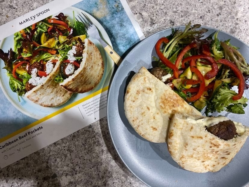 """Finished meal, """"Caribbean Beef Pockets"""" sitting atop it's recipe card"""