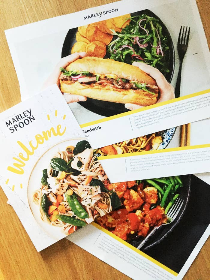 Marley Spoon welcome pack showing three recipe cards with delicious food photography