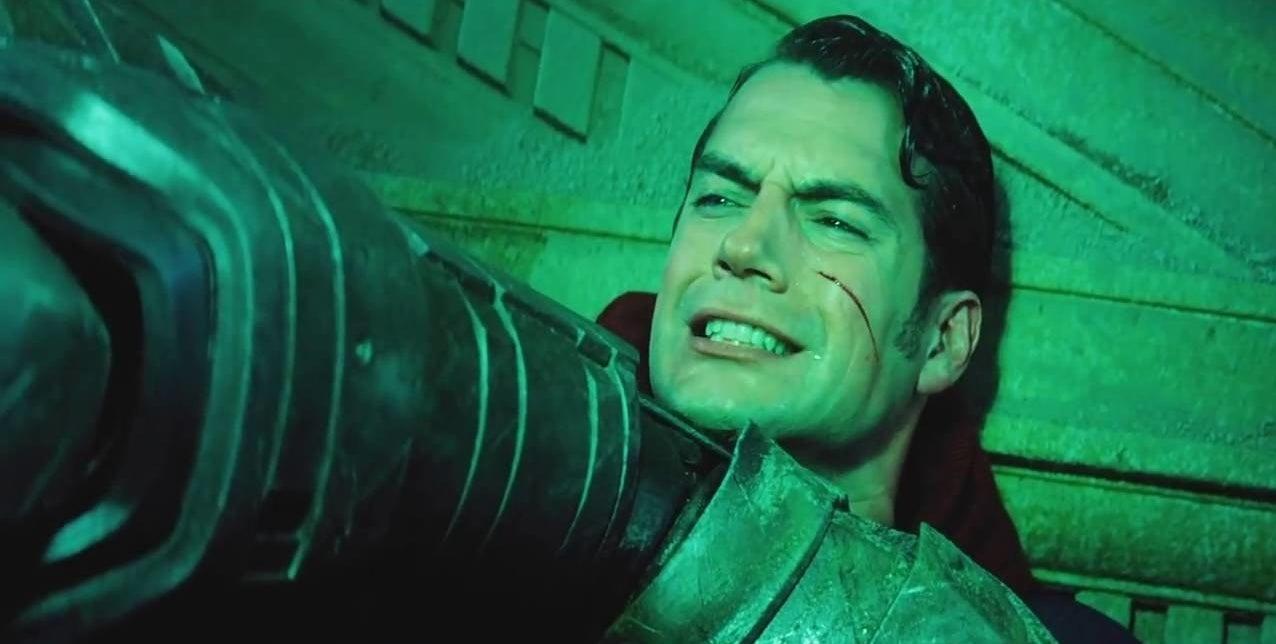 Batman chokes Superman