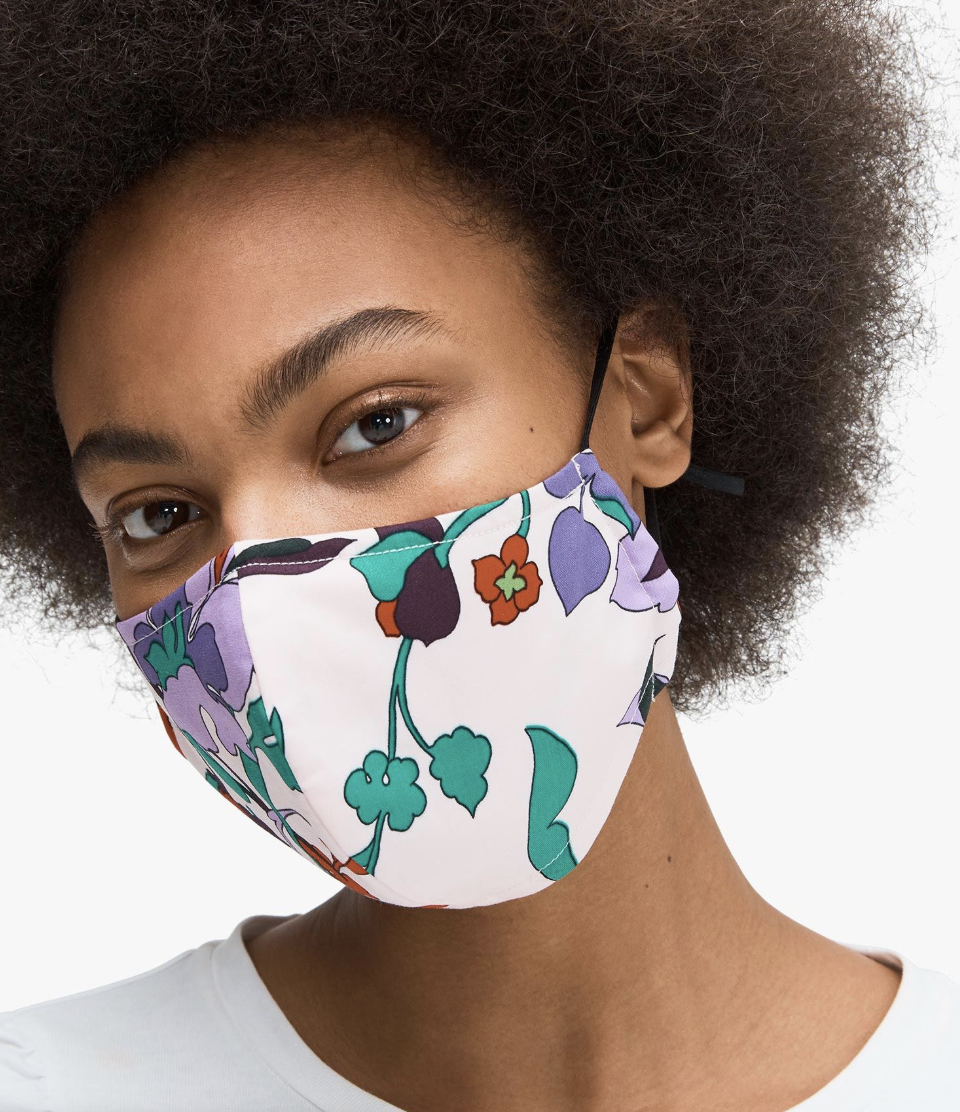 A model in a pink floral face mask