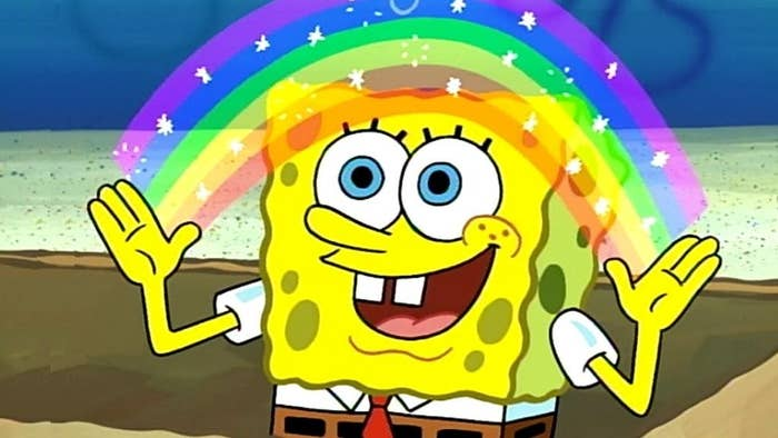 Spongebob standing in a box, happily creating a bright rainbow with his hands