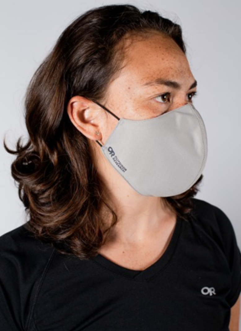 A model in a gray face mask