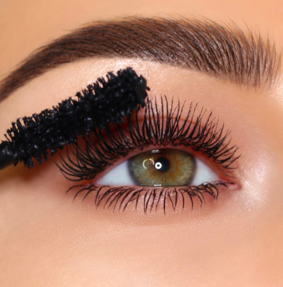 A model wearing the mascara and showing elongated lashes
