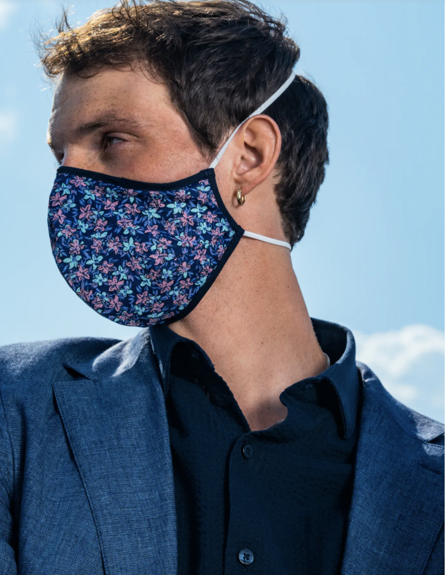 A model in a blue and pink floral face mask