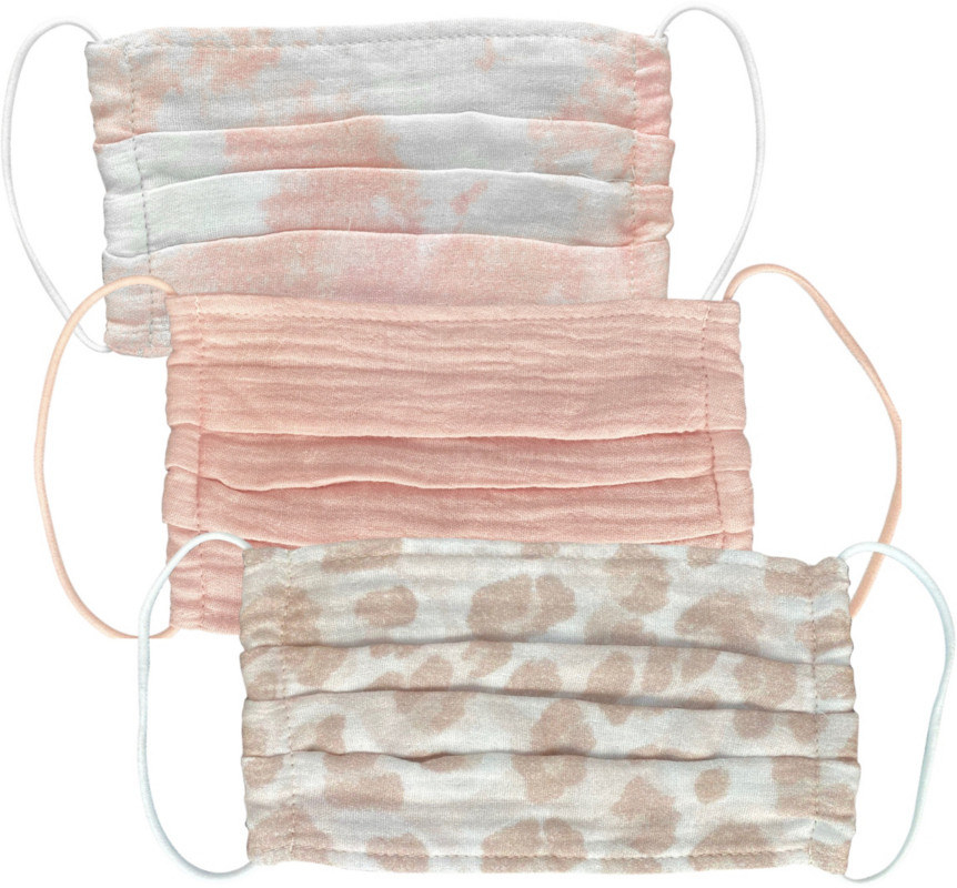 A tie-dye, solid, and animal print trio of masks all in blush pinks and beiges