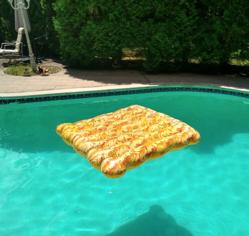 A large rectangular float shaped like an uncooked pack of ramen in a reviewer's pool