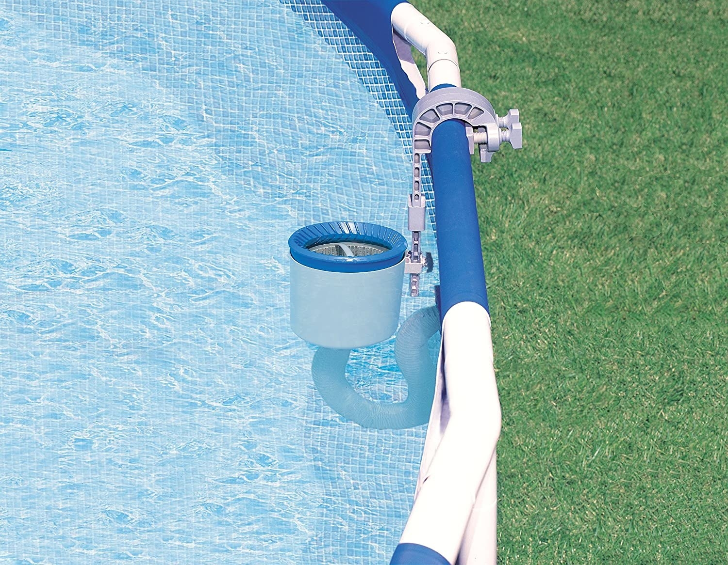 The skimmer mounted to the side of an above-ground pool