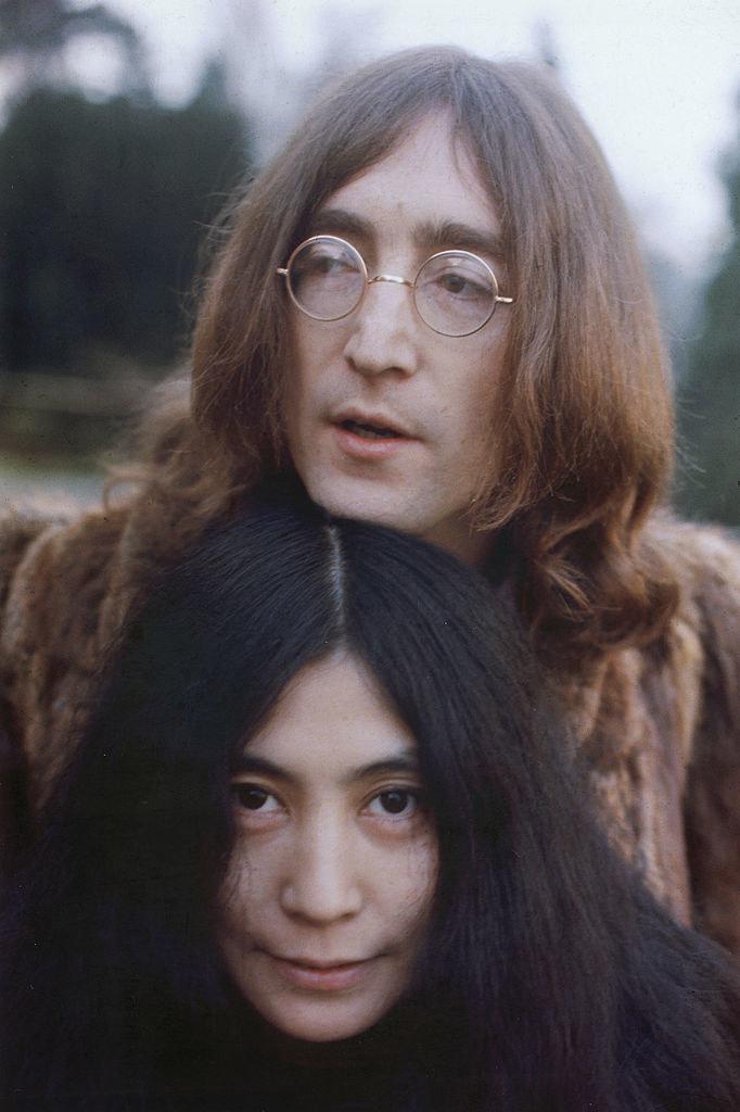 John Lennon standing behind his love Yoko Ono