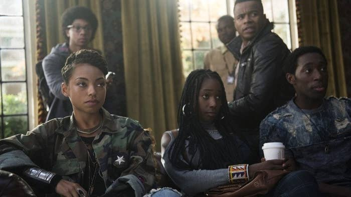 "The cast of ""Dear White People"" sit on couches looking on in disbelief."