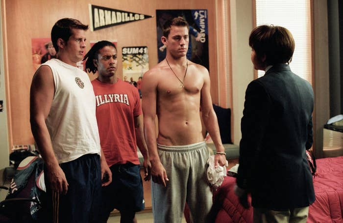 """Three boys look on in shock at Amanda Bynes in """"She's the Man"""" dressed as a boy."""