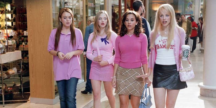 "All four 'Plastics' in ""Mean Girls"" walk around the mall wearing pink outfits."